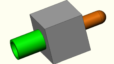Manifold block with 2 attached pipes.